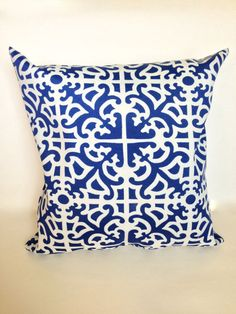 Blue geometric lattis trellis indoor outdoor by JaimeInteriors, $13.00 on Etsy.  Good price, may be a little too dark?  I like it A LOT though, with the background of blue and print of white, the opposite of the storage bench I have.