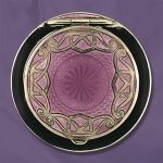 This compact features a beautiful purple guilloche enameled top with scrolling silver inlay and black enameled trim.