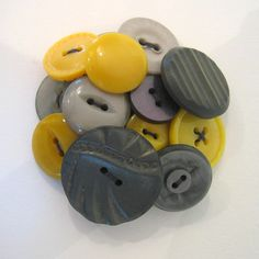 Button Brooch. You could also do this with hair pins or bracelets.  This page actually features a lot of great ideas featuring buttons, which you can get cheap at craft stores.