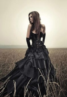 Gothic black gown in a sea of wheat