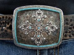 @bucklexpressions - she has some totally awesome belt buckles