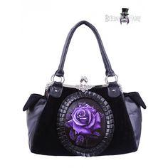 Kabelka PURPLE ROSE je vyrobena ze silného černého sametu a umělé kůže. Ve  středuje potisk fialové růže v oválu zdobeném kůží. Rám z nerezové oceli je zdoben květinovými ornamenty a bílými zirkony.