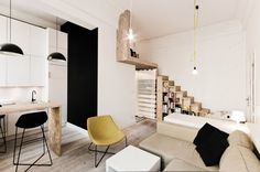 The designers fitted a bed area over a wardrobe, accessible via a small wooden staircase