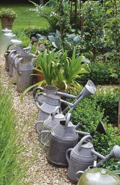 Vintage watering cans by angelica
