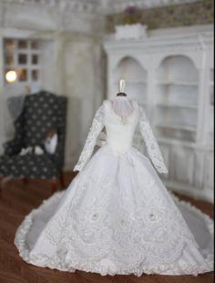Handmade wedding dress in white silk on a mannequin
