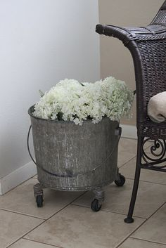 I just did this same thing with my Grandma Stucki's antique mop bucket.  I love it!