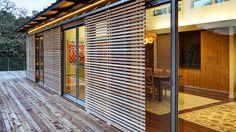 Blu Homes. Sliding wood slat screen