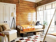 Idea for daybed attached to a wall using heavy rope.