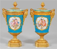 A pair of ormolu mounted Sevres porcelain vases. French, 19th Century.