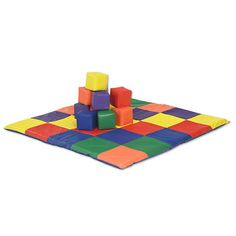 This patchwork toddler mat and blocks are made from colorful vinyl with super-soft furniture-grade foam cores, keeping playtime safe and stimulating for eve