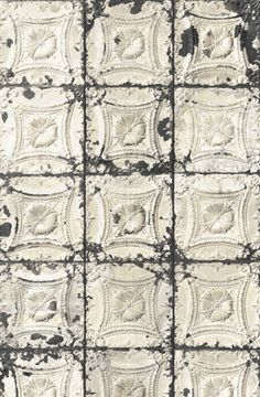 Tin tile wallpaper by Merci in Paris.