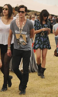 """fuckyeahmattsmithswardrobe: Matt Smith And Daisy Lowe Backstage At The Virgin Media Louder Lounge, V Festival 2011 (picture submitted by Lisirose) Ladies and gentlemen, if you've ever spent a sleepless night wondering why no pictures exist of Matt Smith wearing an article of clothing bearing the word """"hooker,"""" FEAR NO MORE! All your hooker-clothing-based dreams have finally come true."""