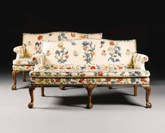 A PAIR OF GEORGE II WALNUT AND UPHOLSTERED SOFAS CIRCA 1740