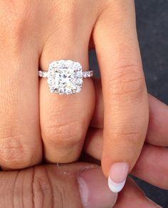Princess cut diamond with halo engagement ring