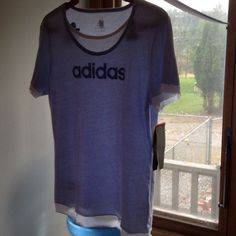 NWT large Adidas T-shirt New pale blue sheer with white underlay.  It is 65% polyester and 35% cotton for a very soft feel. Adidas Tops Tees - Short Sleeve