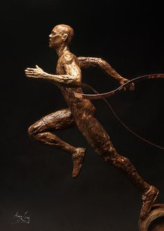 """A detail photo of the runner in this sculpture finalist in the 2012 United States Olympic Art Competition about Excellence and Friendship in the Olympic Games created from steel-reinforced Hydrostone with bronze patina and copper measuring 24"""" x 25"""" x 5"""" by Adam Long (this work is also available as a limited edition bronze)."""