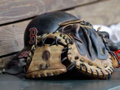 Jason Varitek's helmet and glove on the bench in the Bosox dugout.