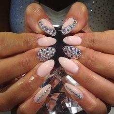 Light pink nude and rhinestone stiletto nails