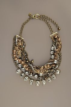 SEQUIN | Multi Chain And Crystal Statement Necklace in Gold - StyleSays