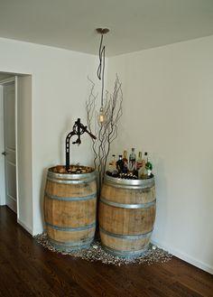 Wine barrel bar with carefully selected French oak barrels w natural patina, steampunk style oversized wine opener, Restoration Hardware pendant light w oversized filament bulb.