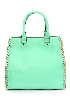 Check it out from Lulus.com! Your favorite new sweetie has just arrived... the My Chain Squeeze Mint Handbag! Mint green vegan leather features golden chains woven along the sides for a chic dose of shine. Unsnap the top to reveal an on-trend black and white striped lining, plus three additional pockets. Tote from twin handles with a 6