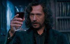 """In Order of the Phoenix, Sirius is the first to stand at a table of 13. 