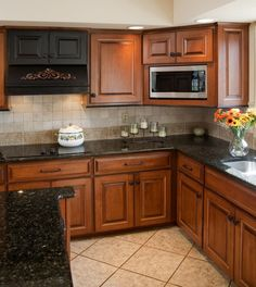"""Kitchen Cabinet Restoration: Victorian Antique """"Honey"""" finish with hand applied """"Warm Brown"""" glaze over hardwood sugar maple. Turnings and accents finished in Old World """"Antique Slate""""."""