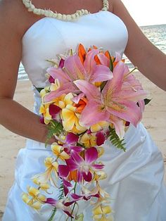 Stargazer Lily & plumeria wedding bouquet - Colorful + gorgeous - Mel C.