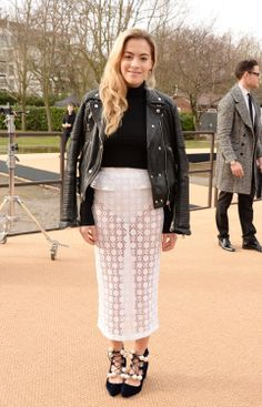 Chelsea Leyland wears a Burberry Prorsum biker jacket with a S/S 14 skirt, and House of Holland shoes