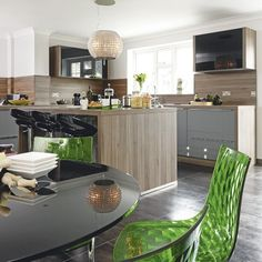 Splashbacks in the same material as the cabinetry creates a polished look in this stylish kitchen.