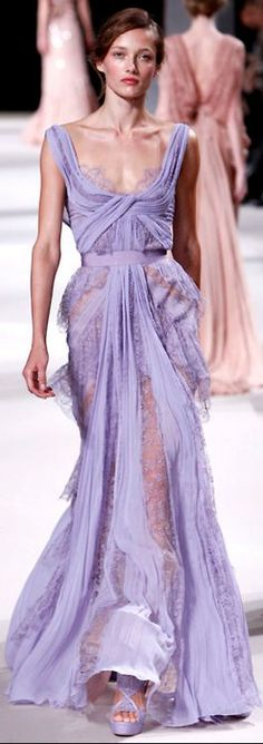 Elie Saab makes astoundingly beautiful dresses...lacey sheer and wrapping, so pretty & delicate