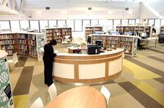 Interesting color scheme, white ceiling.  --- school library design - Google Search