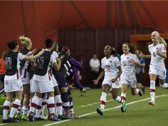 Canada's Ashley Lawrence (3rd R) celebrates with the bench after scoring against the Netherlands' during a 2015 FIFA Women's World Cup Group A match at the Olympic Stadium in Montreal on June 15, 2015.
