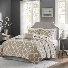 The Madison Park Essentials Merritt Coverlet Set creates a simple yet chic look in your space. The fretwork design creates a modern look with its white design on a rich taupe base. This set is completely reversible to a white base with taupe design allowing you to change the feel of your room instantly. An embroidered decorative pillow completes this look.