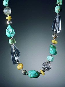 """Necklace of fine blue Chinese turquoise in various shapes, with Baltic butterscotch amber, rock crystal and handmade Balinese sterling. 17""""l. Os separadores metálicos são """"margaridas"""" - Souleart Silver Jewelry - Michelle Soulé"""
