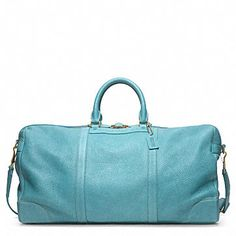 See what I mean? Coach Men's travel weekend bags in a delicious blue.