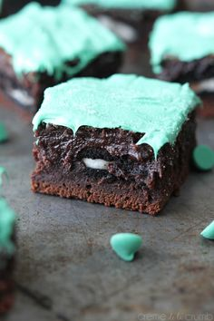 Delicious Mint chocolate Christmas brownies  Fudgey chocolate brownies, stuffed with oreos and topped with mint chocolate! Author: Tiffany Recipe type: Dessert Serves: 12 INGREDIENTS 1 cup butter ⅔ cup cocoa powder 1 teaspoon vanilla 4 eggs 1½ cups sugar ½ cup brown sugar 2 cups flour 12-16 oreos 1 cup mint chips Optional: addit