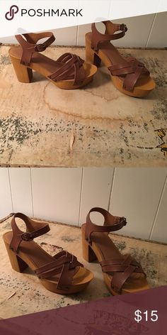 Tan sandals with heels Tan with brass brads. Worn once. Shoes Sandals
