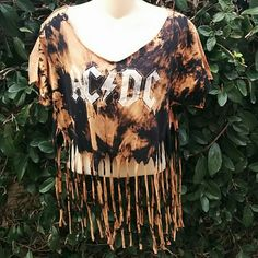 ACDC FRINGE TEE ACDC fringe cut up bleached out tee.  One size fits most. Fits a size medium to large best.  Tie back on back neck so you can adjust how low you want off the shoulder. Hippie Chic Tops