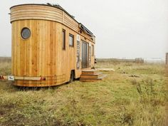 "The Wohnwagon (""living wagon"") is built from locally sourced Austrian woods and has sheep wool insulation, solar panels, a living roof and a water circulation system that uses marsh plants to clean and re-use greywater. 