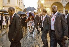 Obama's huge security detail surrounded the president and his family as they walked throug...