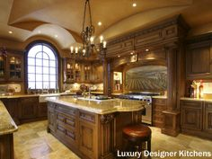 Beautiful remodeled kitchen with granite counters, tile flooring, large kitchen island and stained-wood cabinets. Traditional kitchen also includes a gorgeous tuscan painted scene on the backsplash.