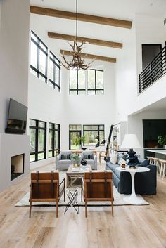 Modern Cabin on the Lake Photo Tour - Modern Cabin Interior Design, warm wood floors shiplap walls, lakehouse design – Studio McGee Blo - Modern Cabin Interior, Cabin Interior Design, Interior Design Minimalist, Cabin Design, Modern Cabin Decor, Modern Design, Modern Cabins, Interior Decorating, High Ceiling Decorating