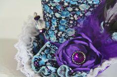 Alice In Wonderland Mini Top Hat Steampunk by MeraVDesignCompany, $40.00 #MeraVDesignCompany #minitophat #hat #womenaccesories #madhatter #steampunk #turquoise #summer #summerhat #flowers #aliceinwonderland #gothichat #victorianhat #teapartyhat #bridalhat #customhat #handmade #etsy #stickpin #weddinghat #wedding #greenteal #purplehat