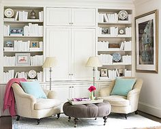 comfy chairs and round tufted ottoman, book storage. living room?
