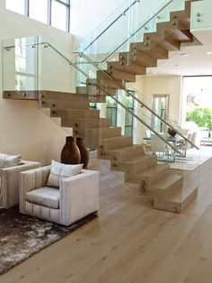 Visit our online gallery to see upcoming and completed projects. We aim to inspire you during the creative process to help make your dream project a reality. Glass Stairs Design, Staircase Design Modern, Staircase Railing Design, Home Stairs Design, Modern Stairs, Home Room Design, Modern House Design, 3 Storey House Design, Building Stairs