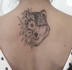 wolf half flowers tattoo on back #flowertattoosonback