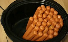 Cook hot dogs for a large crowd in the slow cooker: Do not add water, 2 hours on high, 4 hours on low. Stand them upright for a very large crowd or just throw them in for a smaller bunch. #partyfood