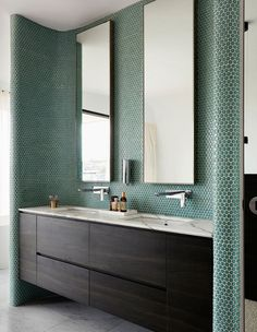 Sea green tiles lining the bathroom walls reflect the tranquility of living in a coastal location. Photo – Prue Ruscoe