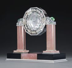 Cartier Rock Crystal and Rose Quartz Two Pillar Panther Mystery Clock